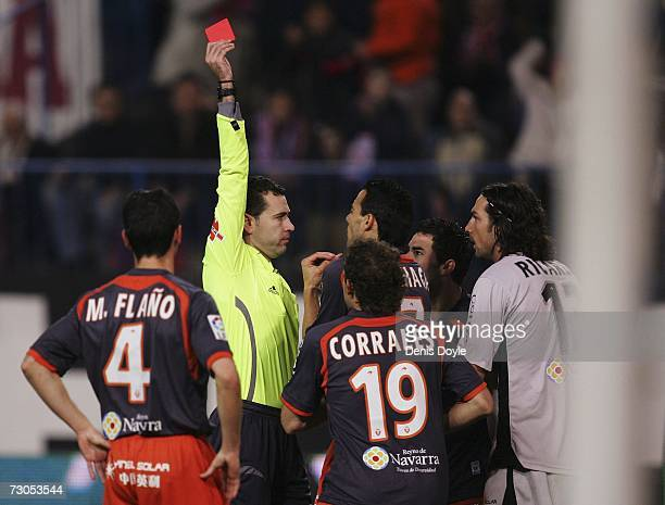 Referee Vicente Lizondo hands out a red card to goalkeeper Ricardo of Osasuna during the La Liga match between Atletico Madrid and Osasuna at the...