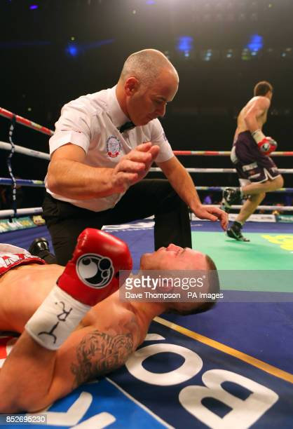 Referee Victor Loughlin looks down at Luke Blackledge after he was knocked out by Rocky Fielding during their Commonwealth Super Middleweight Title...