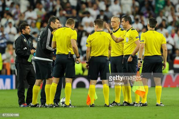 Referee Viktor Kassai and Team during the UEFA Champions League Quarter Final second leg match between Real Madrid CF and FC Bayern Muenchen at...