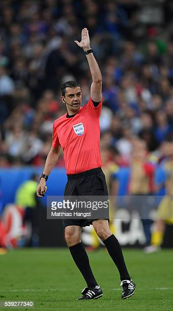 Referee Viktor Kassai gestures during the UEFA Euro 2016 Group A match between France and Romania at Stade de France on June 10 2016 in Paris France