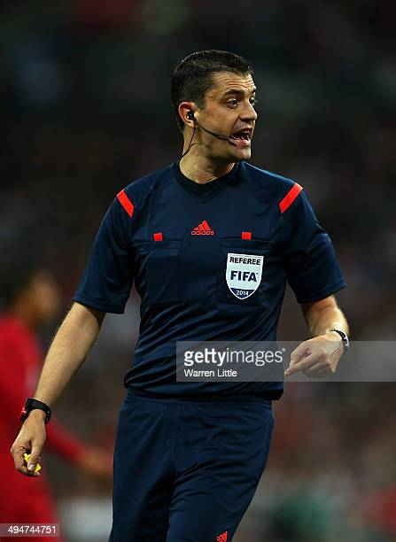 Referee Viktor Kassai in action during the international friendly match between England and Peru at Wembley Stadium on May 30 2014 in London England