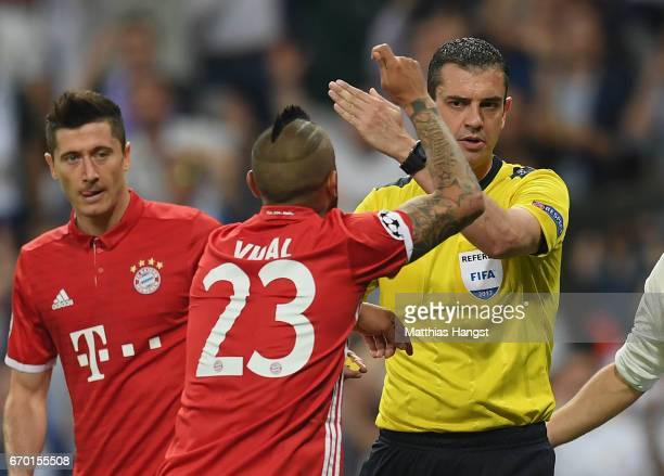 Referee Viktor Kassai in action during the UEFA Champions League Quarter Final second leg match between Real Madrid CF and FC Bayern Muenchen at...