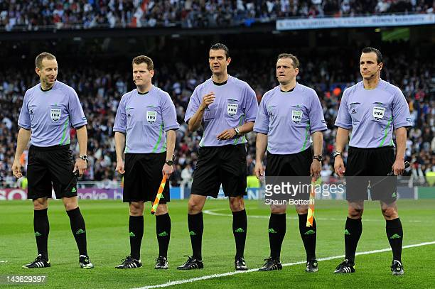 Referee Viktor Kassai lines up with the match officials during the UEFA Champions League Semi Final second leg between Real Madrid CF and Bayern...