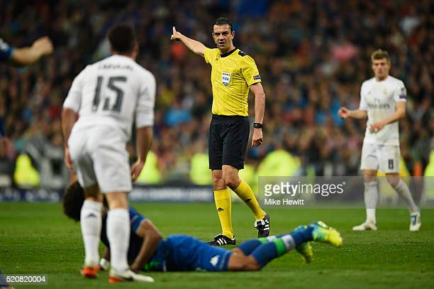 Referee Viktor Kassai of Hungary in action during the UEFA Champions League quarter final second leg match between Real Madrid CF and VfL Wolfsburg...