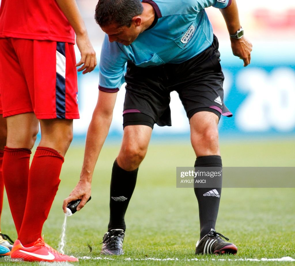 Referee Viktor Kassai of Hungary marks the position of the ball with a spray on June 24, 2013 before a free kick during the group stage football match between Cuba and Nigeria at the FIFA Under 20 World Cup at the Kadir Has Stadium in Kayseri . AFP PHOTO / Aykut AKICI USE