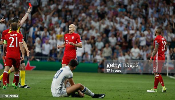 Referee Viktor Kassai shows a red card to Arturo Vidal of Bayern Muenchen during the UEFA Champions League Quarter Final second leg match between...