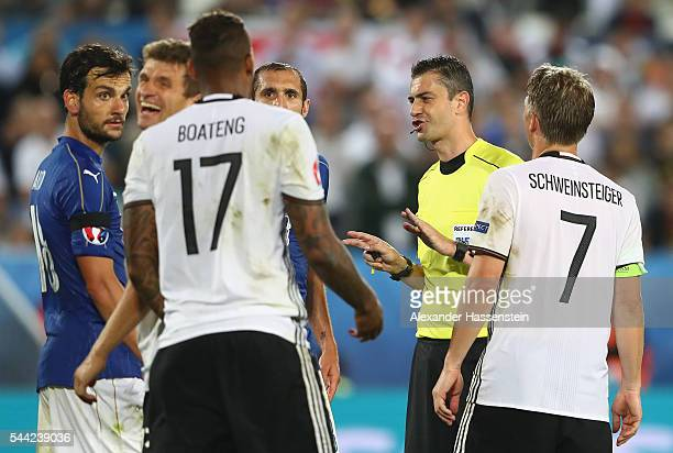 Referee Viktor Kassai talks to players during the UEFA EURO 2016 quarter final match between Germany and Italy at Stade Matmut Atlantique on July 2...