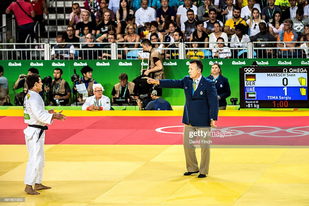 Referee Vincent Druaux of France hands German favourite Sven Maresch a hansokumake for passivity in his u81kg opening contest against Sergiu Toma of...