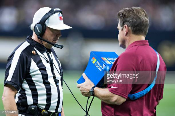 Referee Walt Coleman watches a replay during a game between the Washington Redskins and the New Orleans Saints at MercedesBenz Superdome on November...