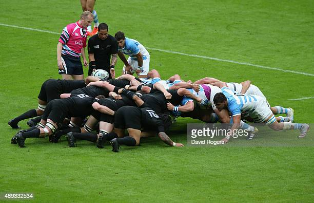 Referee Wayne Barnes observes the scrum during the 2015 Rugby World Cup Pool C match between New Zealand and Argentina at Wembley Stadium on...