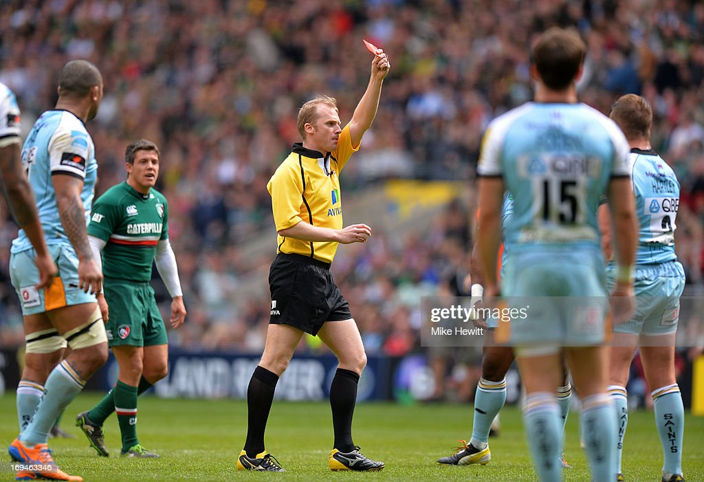 Referee Wayne Barnes shows the red card to <a gi-track='captionPersonalityLinkClicked' href=/galleries/search?phrase=Dylan+Hartley&family=editorial&specificpeople=764177 ng-click='$event.stopPropagation()'>Dylan Hartley</a> (R #2) of Northampton during the Aviva Premiership Final between Leicester Tigers and Northampton Saints at Twickenham Stadium on May 25, 2013 in London, England.