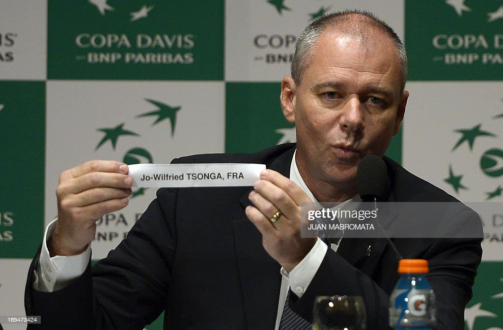 Referee Wayne McKewen displays the name of France tennis player Jo-Wilfried Tsonga during the draw ahead of the 2013 Davis Cup World Group quarterfinals in Buenos Aires on April 4, 2013.