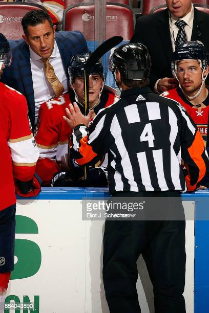 Referee Wes McCauley explains a penalty to Florida Panthers Head Coach Bob Boughner during a break in the action against the San Jose Sharks at the...