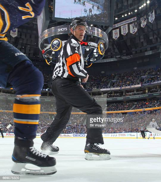 Referee Wes McCauley follows the play during an NHL game between the Buffalo Sabres and Toronto Maple Leafs at the KeyBank Center on April 3 2017 in...