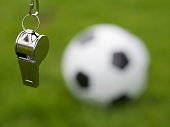 referee whistle in front of soccer ball