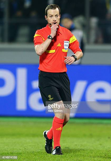 Referee William Collum reacts during the UEFA Champions League Round of 16 match between FC Zenit and Borussia Dortmund at Petrovsky Stadium on...