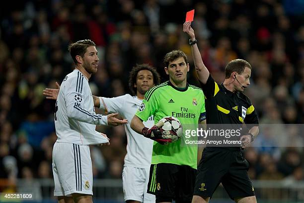 Referee William Collum shows the red card to Sergio Ramos of Real Madrid CF during the UEFA Champions League group B match between Real Madrid CF and...