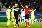 Referee William Collum shows Thomas Foket of Gent a red card during the UEFA Champions League Group H match between KAA Gent and Olympique Lyonnais...