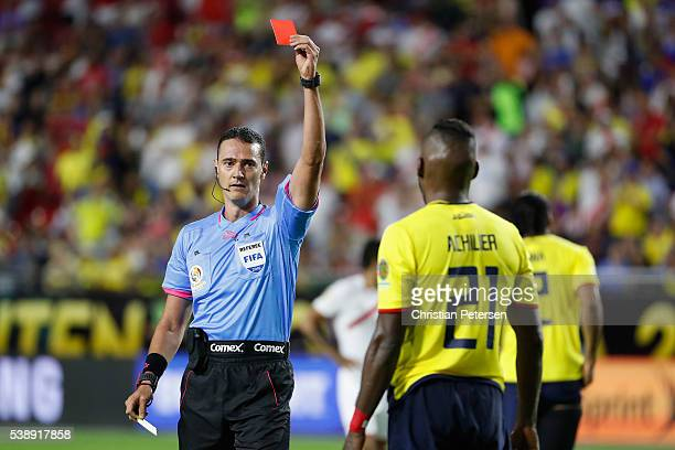Referee Wilmar Roldan issues a red card to Gabriel Achilier of Ecuador during the second half of the 2016 Copa America Centenario Group B match...