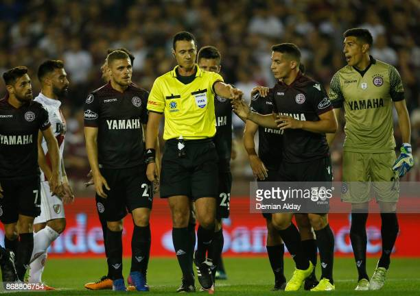 Referee Wilmar Roldan of Colombia marks a penalty for River Plate during a second leg match between Lanus and River Plate as part of the semifinals...
