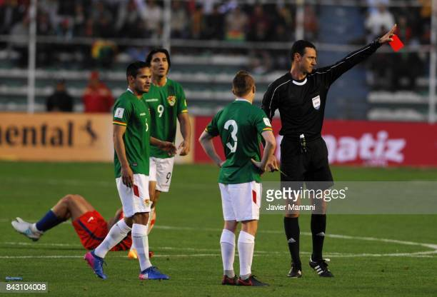 Referee Wilmar Roldan shows a red card to Alejandro Chumacero during a match between Bolivia and Chile as part of FIFA 2018 World Cup Qualifiers at...