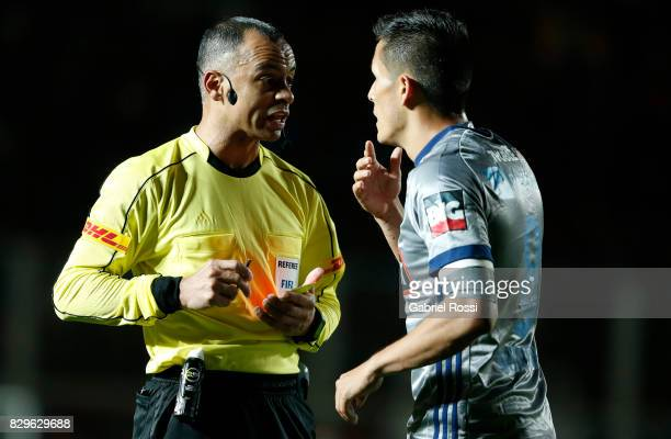 Referee Wilton Pereira Sampaio talks to Marcos Mondaini of Emelec during a second leg match between San Lorenzo and Emelec as part of round of 16 of...