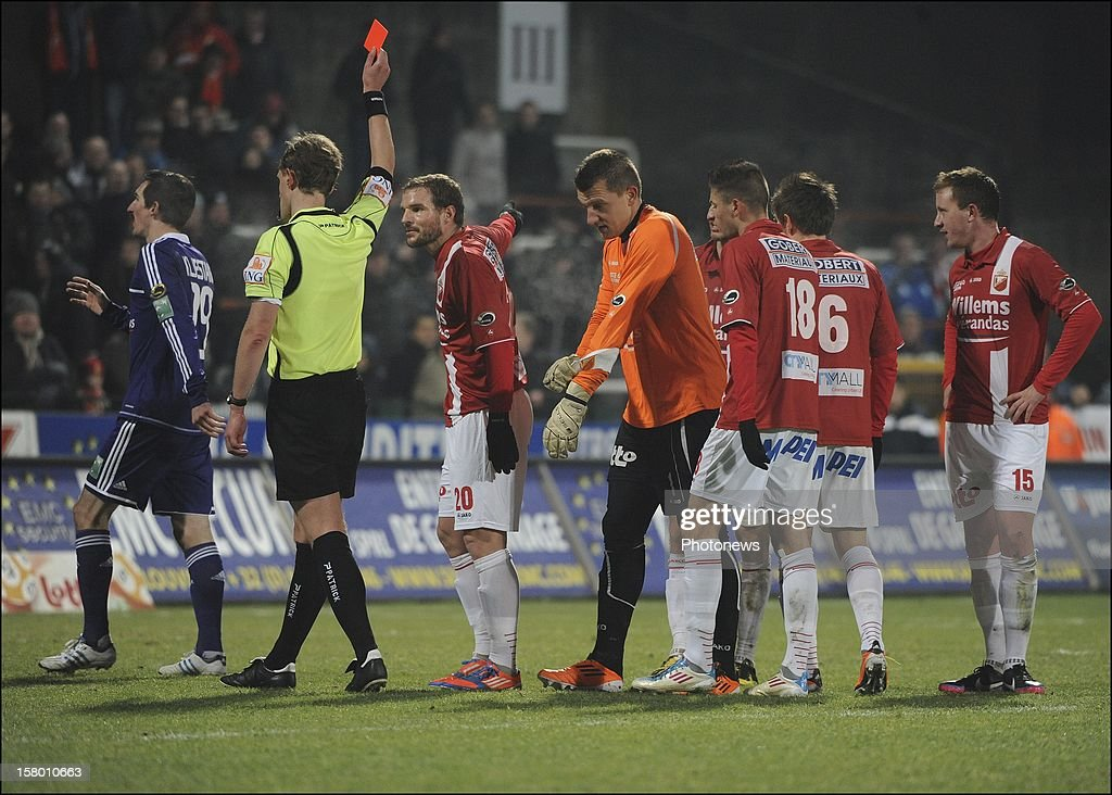 MONS, BELGIUM - DECEMBER 08 Referee Wim Smet gives a red card to Cedric Berthelin (RAEC Mons) during the Jupiler League match between RAEC MONS vs RSC Anderlecht on December 08 , 2012 in Mons, Belgium.