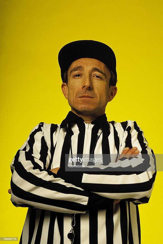 Referee with arms crossed : Stock Photo