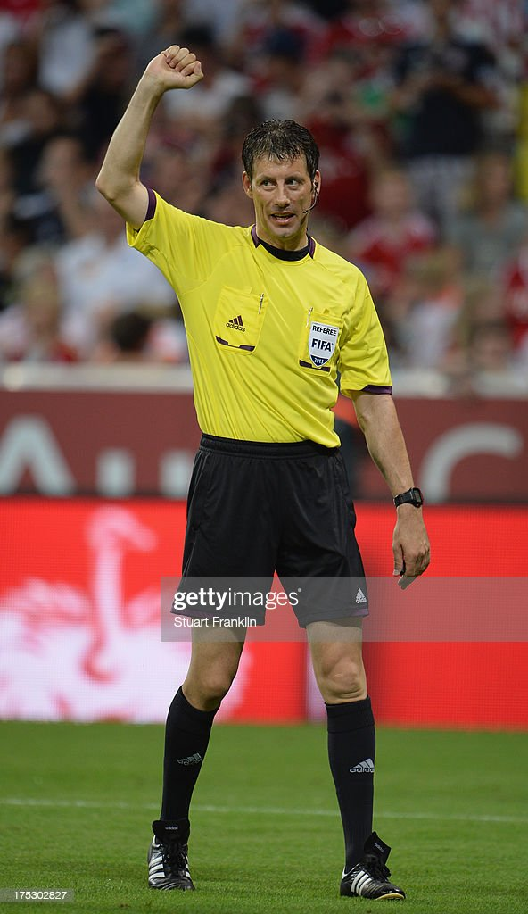 Referee <a gi-track='captionPersonalityLinkClicked' href=/galleries/search?phrase=Wolfgang+Stark&family=editorial&specificpeople=587593 ng-click='$event.stopPropagation()'>Wolfgang Stark</a> gestures during the Audi cup 2013 final between FC Bayern Muenchen and Manchester City at Allianz Arena on August 1, 2013 in Munich, Germany.