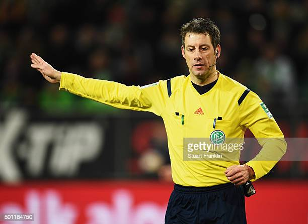 Referee Wolfgang Stark gestures during the Bundesliga match between VfL Wolfsburg and Hamburger SV at Volkswagen Arena on December 12 2015 in...