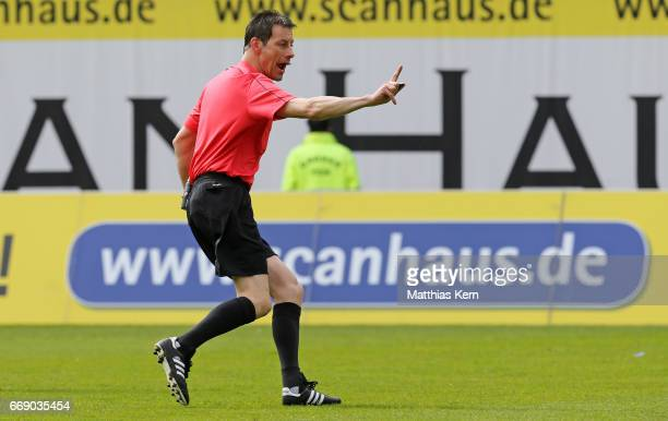 Referee Wolfgang Stark gestures during the third league match between FC Hansa Rostock and 1FC Magdeburg at Ostseestadion on April 15 2017 in Rostock...