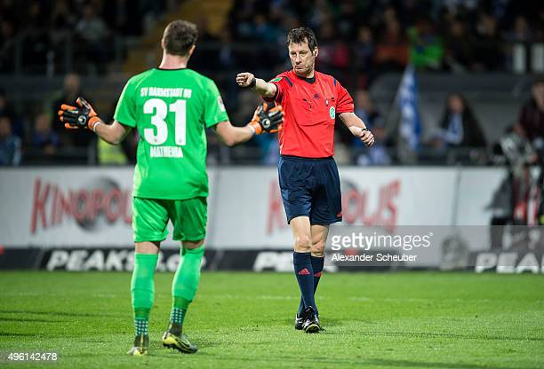 Referee Wolfgang Stark gives a penalty against Christian Mathenia of SV Darmstadt 98 during the first bundesliga match between SV Darmstadt 98 and...