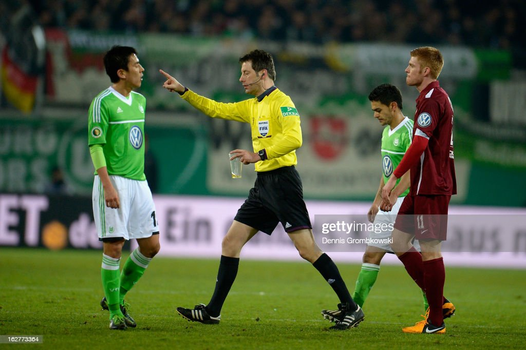 Referee <a gi-track='captionPersonalityLinkClicked' href=/galleries/search?phrase=Wolfgang+Stark&family=editorial&specificpeople=587593 ng-click='$event.stopPropagation()'>Wolfgang Stark</a> holds a cup during the DFB Cup match between Kickers Offenbach and VfL Wolfsburg on February 26, 2013 in Offenbach, Germany.