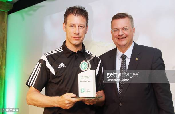 Referee Wolfgang Stark is awarded as referee of the year 2017 by Reinhard Grindel head of the DFB during the awarding ceremony on July 8 2017 in...