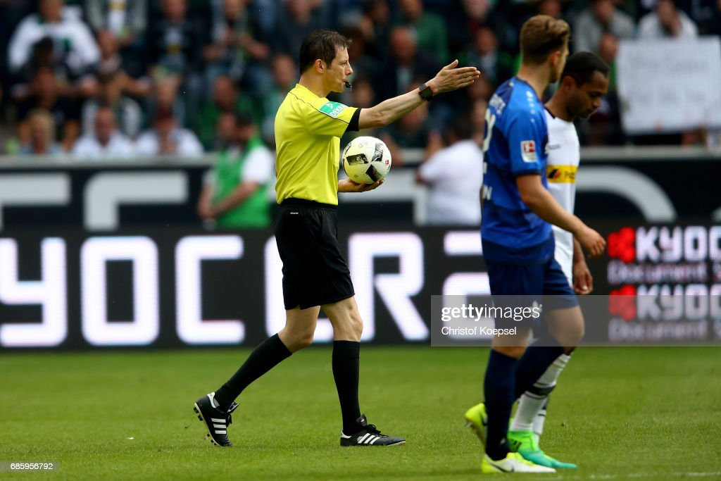 Referee Wolfgang Stark pipes off his last match during the Bundesliga match between Borussia Moenchengladbach and SV Darmstadt 98 at Borussia-Park on May 20, 2017 in Moenchengladbach, Germany.