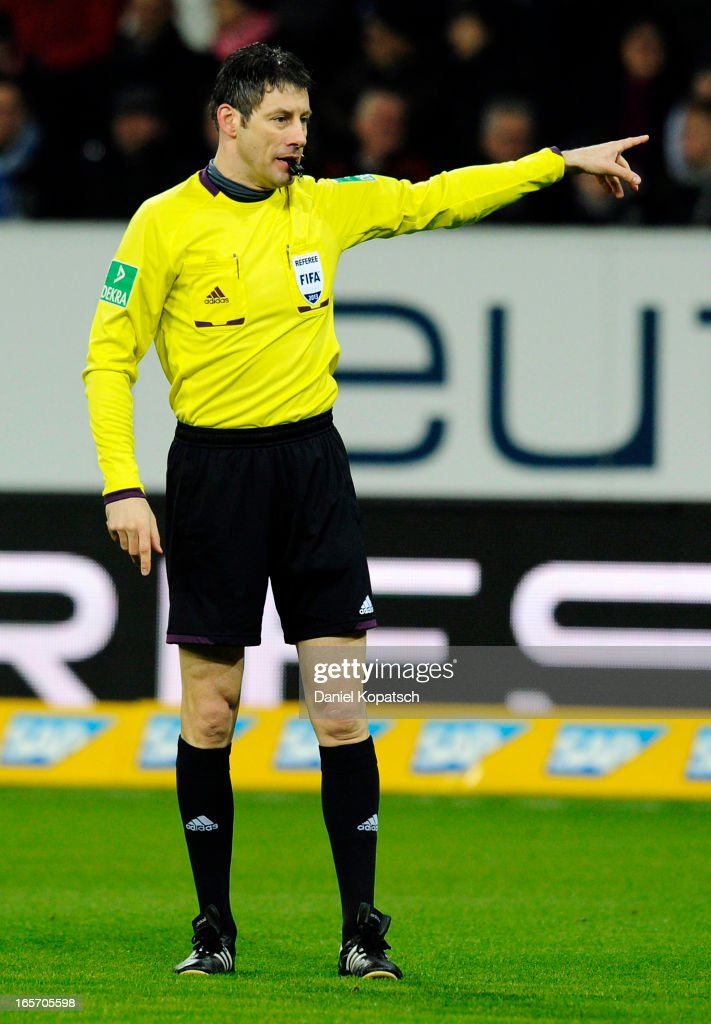 Referee Wolfgang Stark reacts during the Bundesliga match between TSG 1899 Hoffenheim and Fortuna Duesseldorf 1895 at Rhein-Neckar-Arena on April 5, 2013 in Sinsheim, Germany.