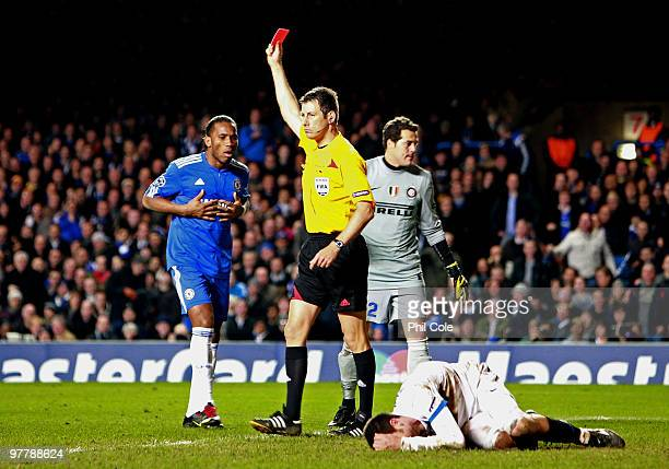 Referee Wolfgang Stark shows the red card to Didier Drogba of Chelsea during the UEFA Champions League Round of 16 second leg match between Chelsea...