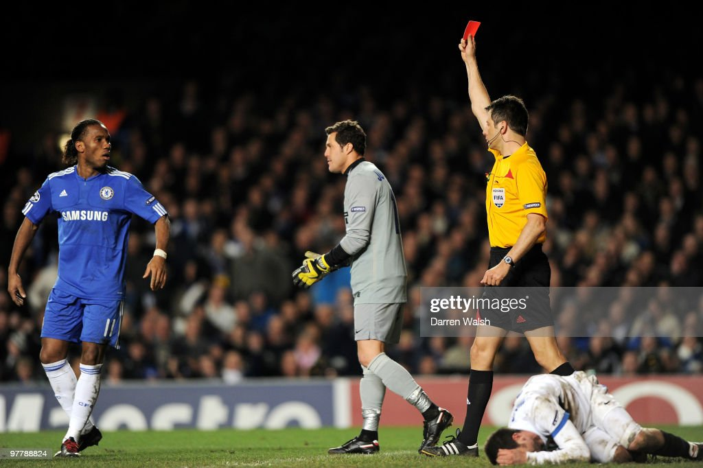 Referee Wolfgang Stark shows the red card to Didier Drogba of Chelsea during the UEFA Champions League Round of 16 second leg match between Chelsea and Inter Milan at Stamford Bridge on March 16, 2010 in London, England.