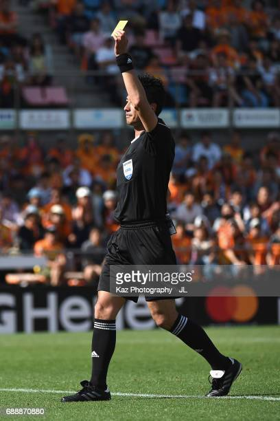 Referee Yudai Yamamoto shows a yellow card to Hiroki Iikura of Yokohama FMarinos during the JLeague J1 match between Shimizu SPulse and Yokohama...