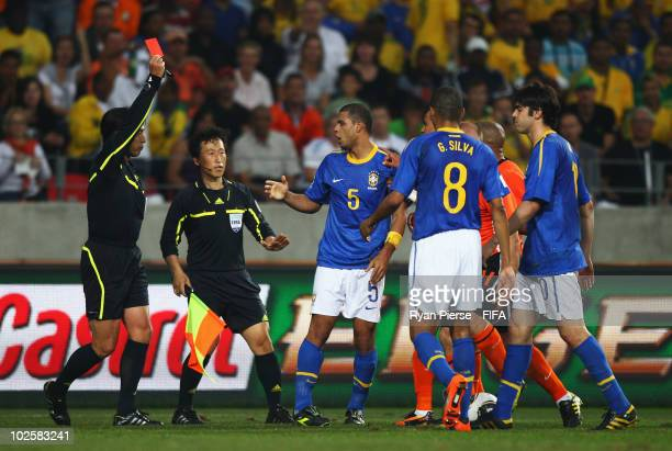 Referee Yuichi Nishimura awards Felipe Melo of Brazil a red card during the 2010 FIFA World Cup South Africa Quarter Final match between Netherlands...