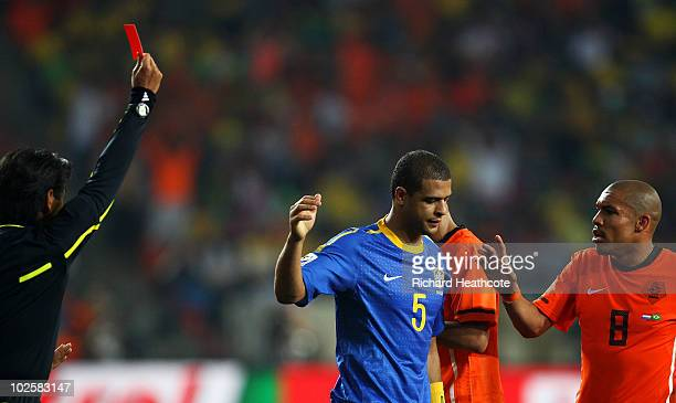 Referee Yuichi Nishimura issues a red card to Felipe Melo of Brazil after he stamps on Arjen Robben of the Netherlands during the 2010 FIFA World Cup...