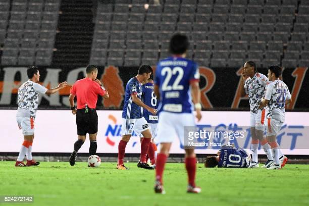Referee Yuzuru Tojo whistle to award an penalty to Yokohama FMarinos during the JLeague J1 match between Yokohama FMarinos and Shimizu SPulse at...