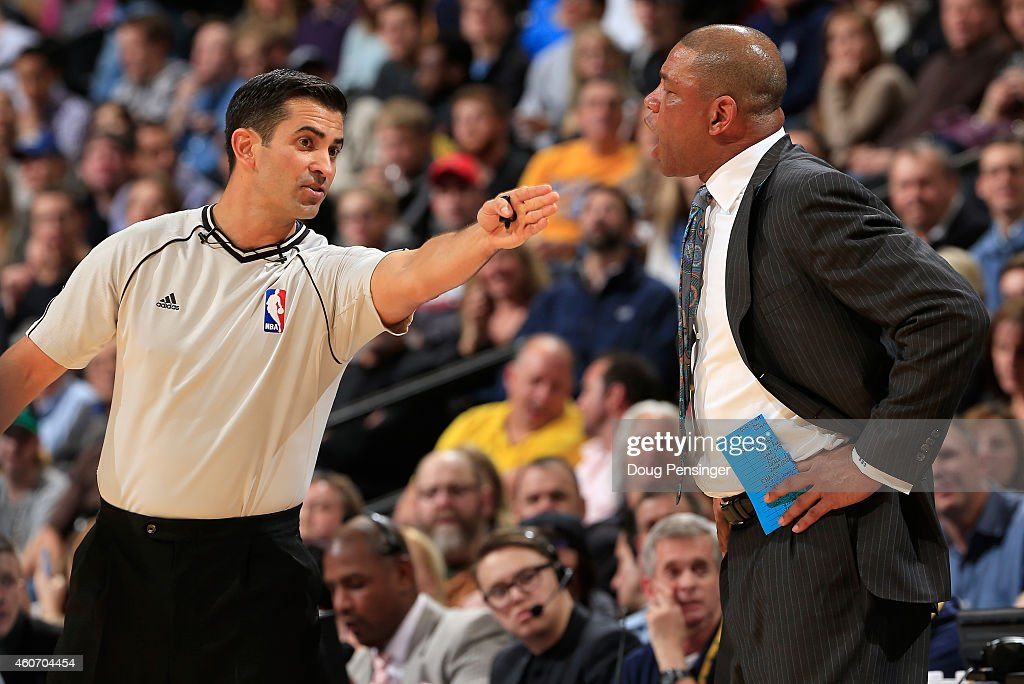 Referee Zach Zarba #28 directs head coach <a gi-track='captionPersonalityLinkClicked' href=/galleries/search?phrase=Doc+Rivers&family=editorial&specificpeople=206225 ng-click='$event.stopPropagation()'>Doc Rivers</a> of the Los Angeles Clippers to return to the bench as he argues a call in the fourth quarter as they face the Denver Nuggets at Pepsi Center on December 19, 2014 in Denver, Colorado. The Nuggets defeated the Clippers 109-106.