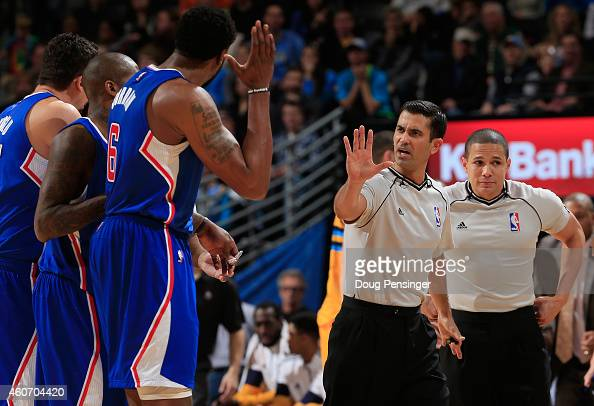 Referee Zach Zarba directs the Los Angeles Clippers to their bench after DeAndre Jordan of the Los Angeles Clippers was called for a flagrant foul...