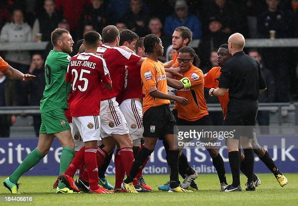 Refereee Nick Kinseley steps in as players square up after Barnet player manager Edgar Davids elbowed Steven Wright of Wrexham in the face during the...