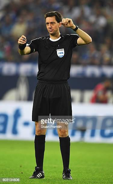 RefereeManuel Graefe gestures during the Bundesliga match between FC Schalke 04 and Bayern Muenchen at VeltinsArena on September 9 2016 in...