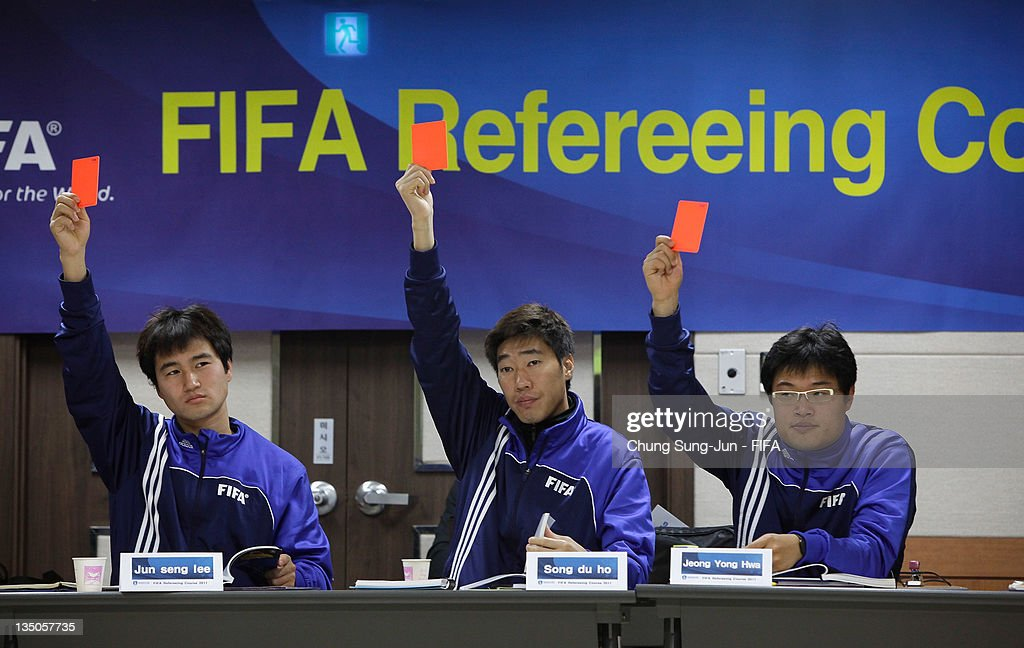 Referee's and Assistant Referee's take part in a theoretical session of the FIFA Refereeing Course on December 6 2011 in Changwon South Korea...