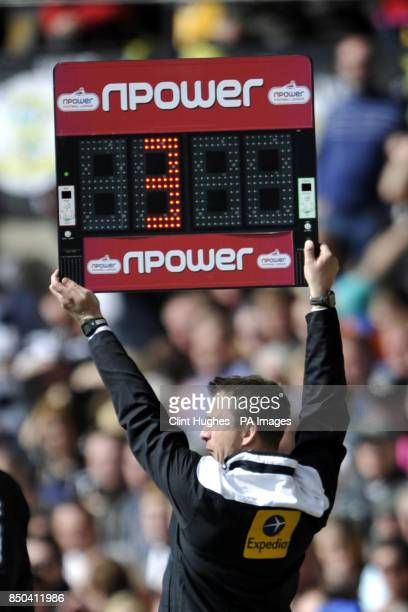 A referee's assistant holds up a substitute board