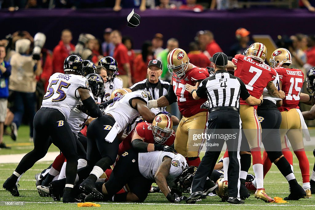Referees attempt to break up fight between members of the Baltimore Ravens and the San Francisco 49ers in the second quarter during Super Bowl XLVII at the Mercedes-Benz Superdome on February 3, 2013 in New Orleans, Louisiana.