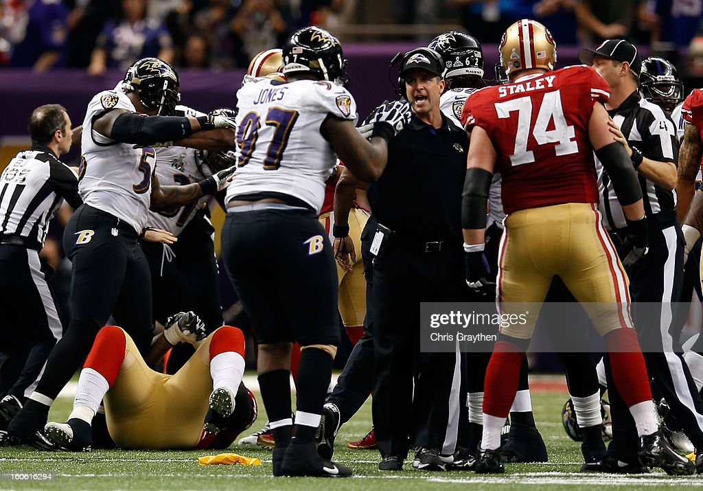Referees attempt to break up fight in front of head coach John Harbaugh of the Baltimore Ravens between members of the Baltimore Ravens and the San Francisco 49ers in the second quarter during Super Bowl XLVII at the Mercedes-Benz Superdome on February 3, 2013 in New Orleans, Louisiana.
